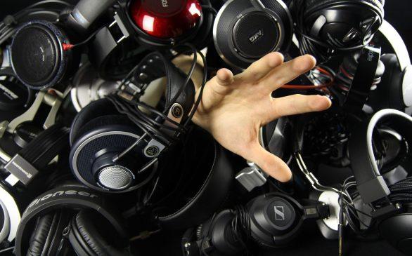 Hand reaching from headphones